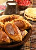 Pie (Pierogi, pirogi) and pancake, russian tradition food — Stock Photo
