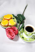 Holiday breakfast, cup of coffe and rose — Stock Photo