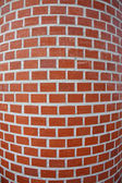 Red curved brick wall texture — Stockfoto