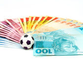 Brazilian currency notes and soccer ball — Stock Photo