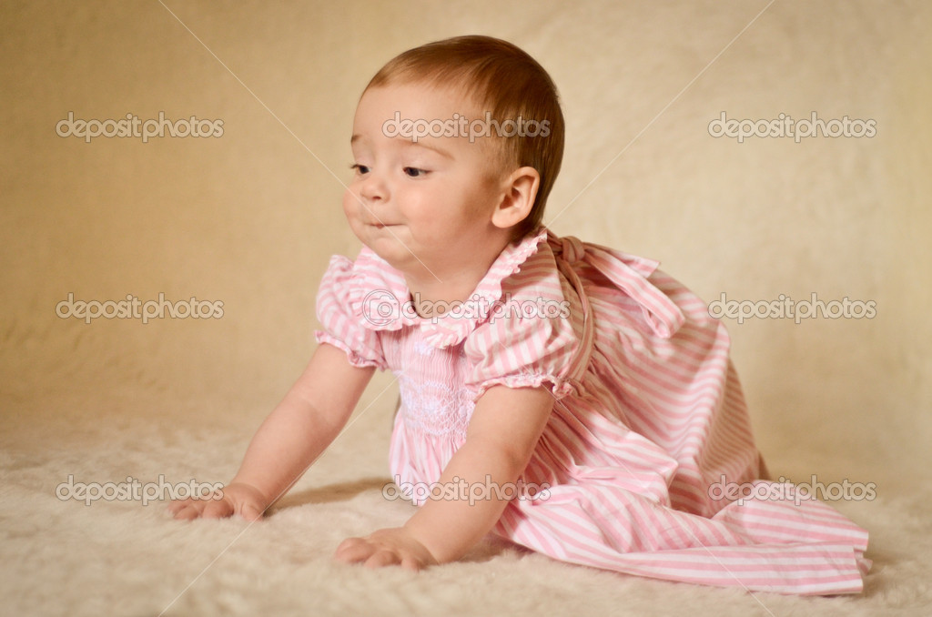 A portrait of a cute caucasian baby or toddler on smooth background. — Stock Photo #14796005