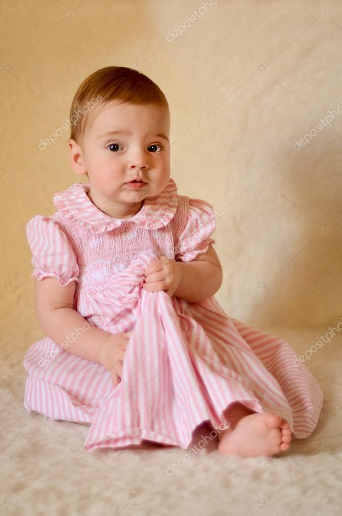 A portrait of a cute caucasian baby or toddler on smooth background. — Stock Photo #14796201