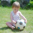 Girl with ball on lawn — Stock Photo