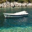 Stock Photo: Small white boat on sea