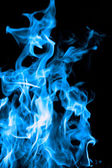 Blue fire on black background — Stock Photo