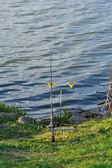 Fishing rod on rack — Stock Photo