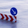 Stock Photo: Direction boards on flooding river