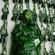 Old military gas on a chemical protective suit woman green — Stock Photo