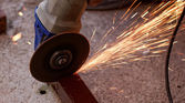 Hand grinder saw the steel — Stock Photo