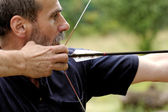 Man shooting with bow — Stock Photo