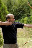 用弓射击的人 — 图库照片