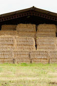 Straw bales under the roof — Stock Photo