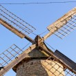 Old wooden mill against the blue sky — Stock Photo