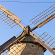 Stock Photo: Old wooden mill against blue sky