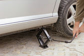 Car lifted up — Stock Photo