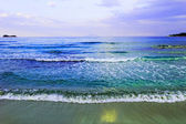 Waves of sea on the sandy beach — Stock Photo