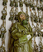 Old military gas on a chemical protective suit woman — Stock Photo