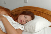 Beautiful girl sleeping in bed — Stock Photo