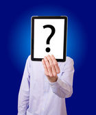 Businessman holding digital tablet with question — Stock Photo