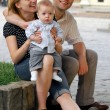 Mother father and child in a city — Stock Photo