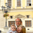 Stock Photo: Mother father and child in city