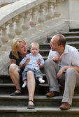 Mother father and child in a park — Stock Photo