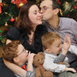 Family near the Christmas-tree — Stock Photo