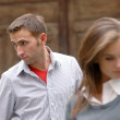 The young couple in the street — Stock Photo