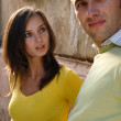 The young couple in the street - Foto de Stock