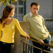 The young couple in the street - Stock Photo