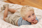 Little boy on the sofa — Stock Photo