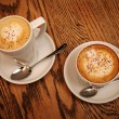 Two cups cappuccino and latte — ストック写真