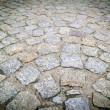 Stock Photo: Paving stones on the old road