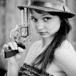 Girl with gun — Stock Photo