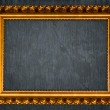 Golden frame on old wall — Stock Photo