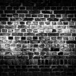 Rough dark brick wall — Stock Photo