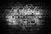 Rough dark brick wall — Stock Photo
