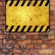 Royalty-Free Stock Photo: Brick wall with warning sign