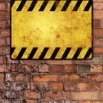 Brick wall with warning sign — Stock Photo