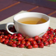 Cup of rosehip tea — Stock Photo #14876313