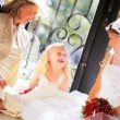 Stock Video: Young Wedding Day Bride Sitting Flower Girl Grandmother