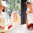 Stock Video: Cute Blonde Flower Girl Laughing Bride Grandma