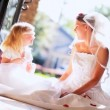 Stock Video: Laughing Bride and Flower Girl