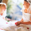 Beautiful Young Wedding Day Bride Sitting Playing Flower Girl - Foto de Stock