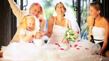 Cute Blonde Flower Girl Laughing Bride Sister and Grandma — Stock Video