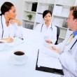 Royalty-Free Stock Vector Image: Multi Ethnic Medical Team Meeting