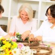 Laughing Ladies Decorating Door Ring - Stock Photo
