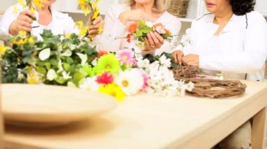 Senior ladies having fun leisure time together flower arranging