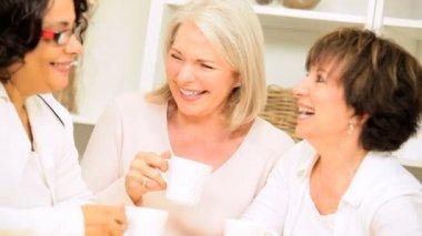 Retired Girlfriends Enjoying Coffee and Gossip — Stock Video
