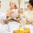 Multi Ethnic Senior Girlfriends Laughing Coffee Cupcakes - Stock Photo